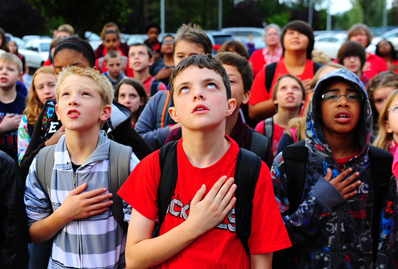 Students from Ramstein Middle School resite the Pledge of Allegiance during a commemoration ceremony, Ramstein Air Base, Germany, Sep. 9, 2011. This year marks the 10th anniversary of the Sep. 11th attacks. (U.S. Air Force photo by Airman 1st Class Brea Miller)